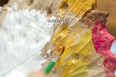 Colorful Paint Splash On Object Stock Photo