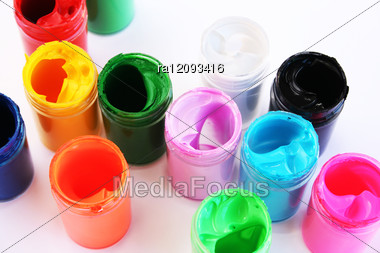 Colorful Paints Bottles On Gray Background. Stock Photo