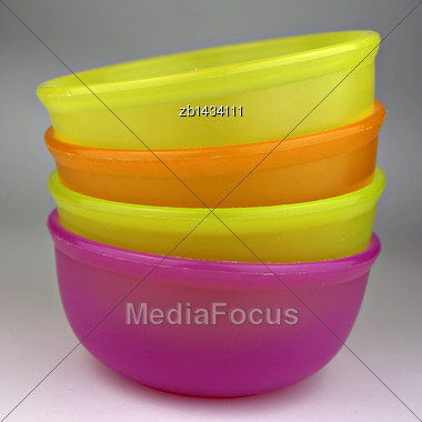 Colorful Plastic Bowls, Stacked And Ready For Use Stock Photo