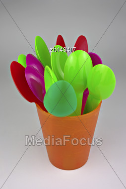 Colorful Plastic Spoons, Stacked And Ready For Use Stock Photo