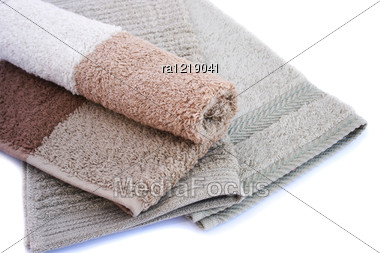 Colorful Towels Isolated On White Background. Stock Photo
