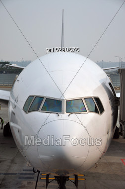 Commercial Airliner Waiting At Airport Stock Photo