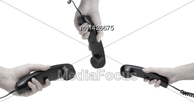 Communication On White. Office Black Telephones With Hands Dialing Stock Photo