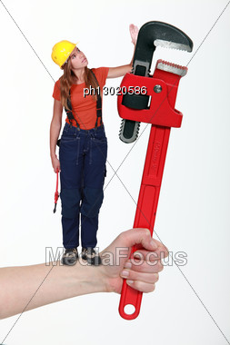 Composite Of A Woman With An Adjustable Wrench Stock Photo