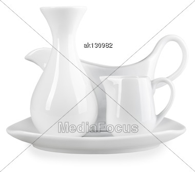 Composition Of Clean Vase For Flowers, Sauceboat And Cream-cup On Square Plate Of Modern-design. Placed On White Background. Close-up. Studio Photography Stock Photo
