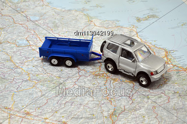 Concept Small Jeep With Trailer Toy Car On Italy Map Stock Photo