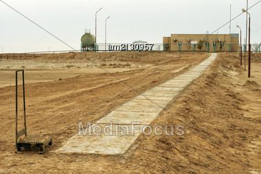 Concrete Path Laid To The Office In The Desert Stock Photo