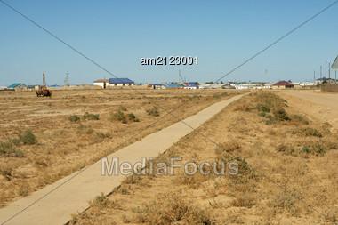 "Concrete Path Towards The Village ""Opornyy"" Kazakhstan. Stock Photo"