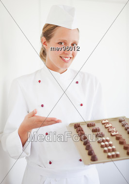 Confectioner With Chocolates Stock Photo