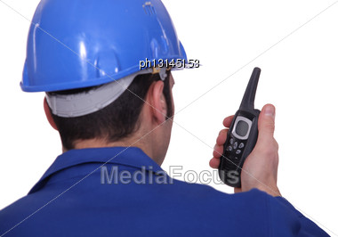 Construction Site Worker With Radio Stock Photo