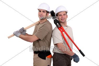 Construction Worker Holding Heavy-duty Tools Stock Photo
