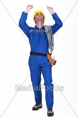 Construction Worker Raising His Hands Stock Photo
