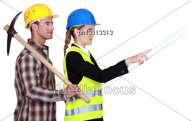 Construction Worker Standing Next To A Civil Engineer Stock Photo