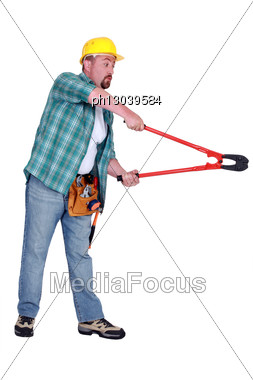 Construction Worker Using Bolt Cutting Tool Stock Photo