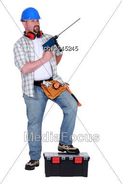 Construction Worker With A Masonry Drill Stock Photo