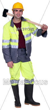 Construction Worker With A Sledgehammer Stock Photo