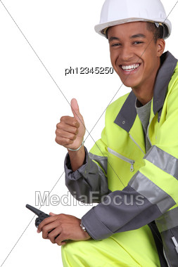 Construction Worker With A Walkie Talkie Stock Photo