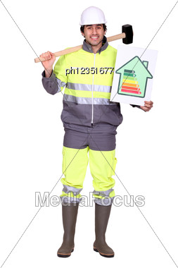Construction Worker With An Energy Rating Card Stock Photo