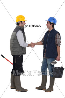 Construction Workers Shaking Hands Stock Photo
