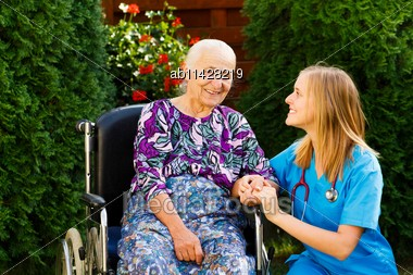Contented Old Woman With Her Kind Doctor At The Nursing Home Stock Photo