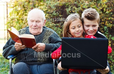 Contrast Between An Old Man's And Children's Lifestyles Stock Photo