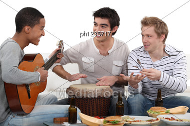 Convivial Meal With Music Stock Photo