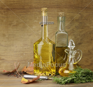 Cooking Oil And Spices On A Wooden Background Stock Photo