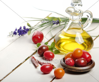 Cooking Oil And Vegetables On A Wooden Table Stock Photo