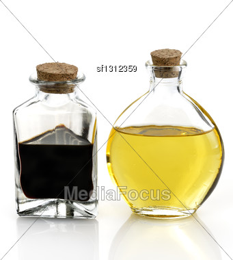 Cooking Oil And Vinegar In The Glass Bottles Stock Photo