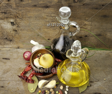 Cooking Oil Vinegar And Spices On Wooden Background Stock Photo