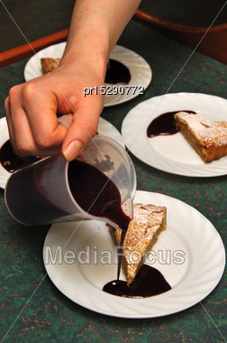 Cooks Adding Sauce To Delicious Homemade Apple Pies Stock Photo