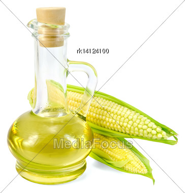 Corn Oil In A Glass Decanter With Two Ears Of Corn Isolated On White Background Stock Photo