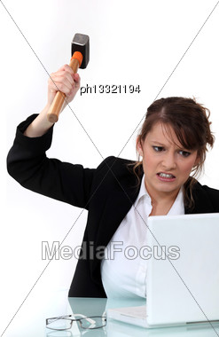 Corporate Woman Mad At Her Laptop Stock Photo