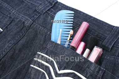 Cosmetics In Blue Jeans Pocket On White Background. Stock Photo