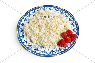 Cottage Cheese With Berries Red Ripe Strawberries On The Plate With A Blue Ornament Is Isolated Stock Photo
