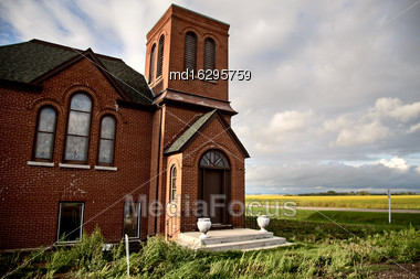 Country Brick Church In Saskachewan Canada Storrm Stock Photo