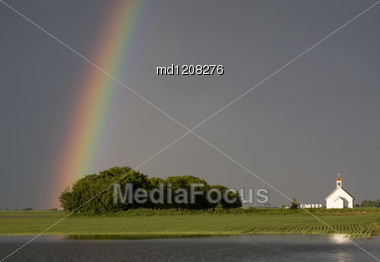 Country Church And Rainbow After Storm Canada Stock Photo