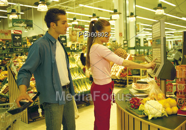 Couple At Grocery Self-Checkout Stock Photo