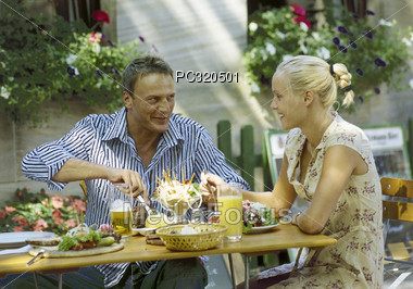 Couple at Outdoor Restaurant Stock Photo