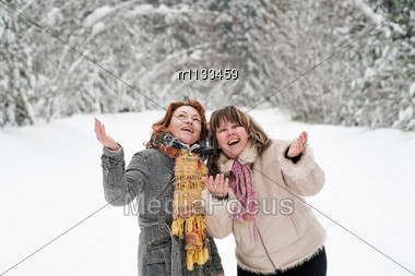 Couple Of Attractive Friends Having Fun On Winters Day In Forest. Stock Photo