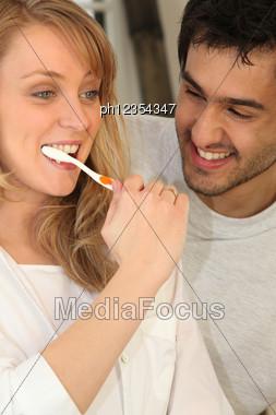 Couple Brushing Teeth Stock Photo