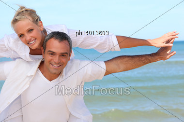 Couple By The Sea Stock Photo