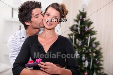 Couple Celebrating Christmas Together Stock Photo