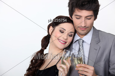 Couple Celebrating Engagement With Champagne Stock Photo
