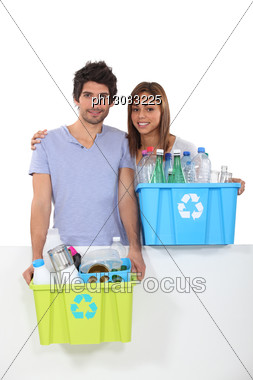 Couple Collecting Plastics For Recycling Stock Photo