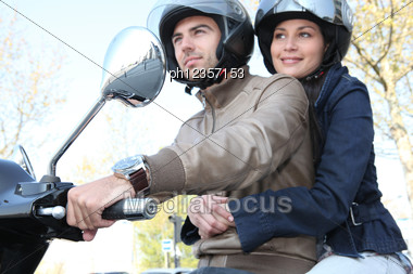 Couple Commuting To Work Stock Photo