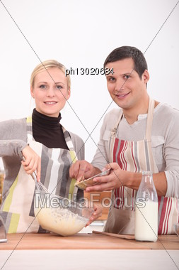 Couple Cooking Stock Photo