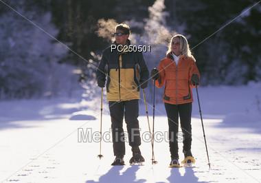 Couple Cross-Country Skiing Stock Photo