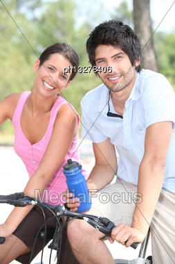 Couple Cycling Together Stock Photo