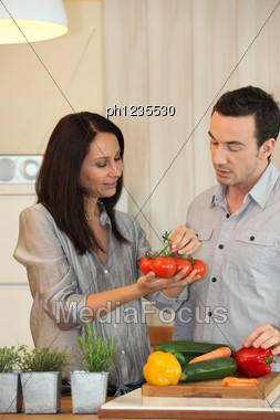Couple Debating Which Vegetables To Cook Stock Photo